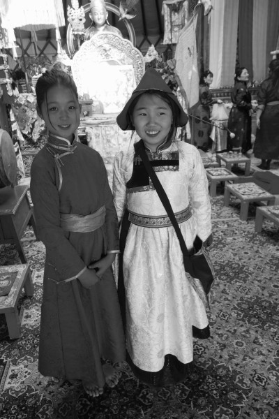 E.Dawaalham (left) and T. Khanaas (right) who is wearing a silk brocade traditional Buryat-style deel (Buriat, degel), and hat sewn for this special occasion by her maternal grand-mother. Dawaalham wears the traditional Khalkha Mongol deel and sash. To not draw the fabric of one's deel in at the waist, with either a sash or a belt, is simply not the done thing.Delgeruun Choira, 5 September 2015. Photo: C.Pleteshner