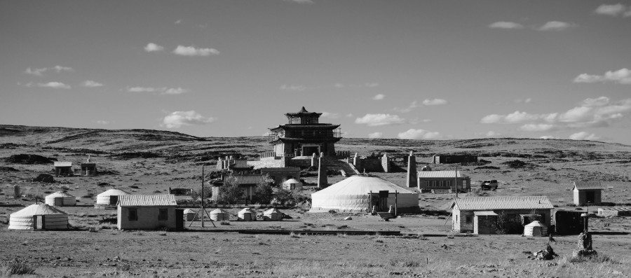Delgeruun Choira, Delgerstogt Sum in Dundgovi Aimag Mongolia. Since (re)construction of the destroyed precinct began onsite in 2004, three main (yet architecturally quite different) structures designed by Zava Damdin and his local associates have emerged: (a) The Joyful Temple of Manjushri (centre-lower left); (b) The Golden Temple (centre-upper); and (c) The Majestic Shining White Palace ger (centre-lower right). September 2015. Photo: C.Pleteshner