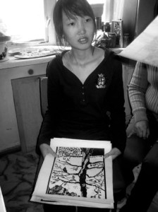 B. Enerel with one of her woodblock prints in the studio she still shares with her mother at the Mongolian Union of Artists' (MUA) building in Ulanbaator 2008.