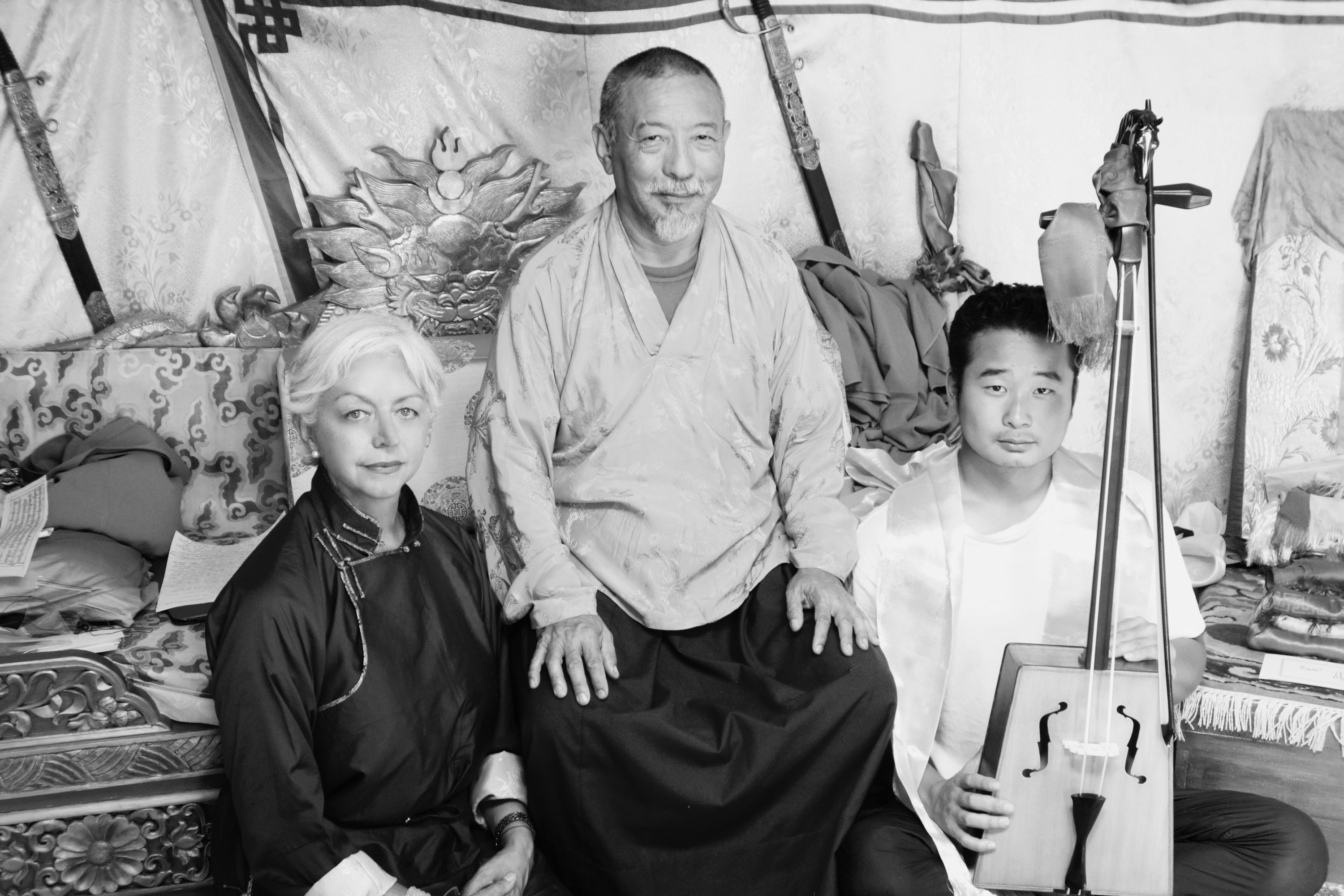 L to R: Catherine Pleteshner, Zasep Tulku from Canada, and Ulziikhishig Temuulen after his morin khuur performance. Delgeruun Choira Ger. Dundgovi Aimag, Gobi Desert Mongolia. 12 September 2013. Photograph: Zava Damdin Institute of Mongolia Photographic Archive.