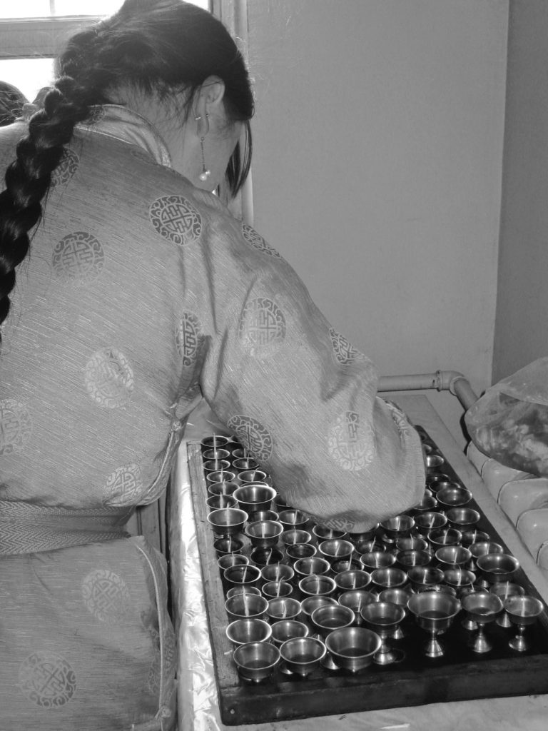 A Tugsbayasgalant Women's Centre ani preparing the traditional one hundred butter lamp offering Ulaanbaator. 21 Sept 2008 Photograph: C Pleteshner