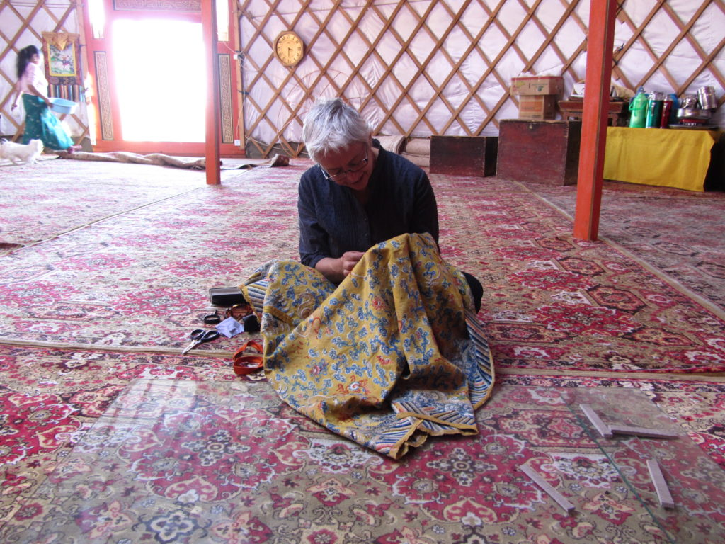 CP mending a traditional silk embroidered parasol umbrella Delgeruun Choira Mongolia 7 October 2011 Photograph by Zava Damdin Rinpoche